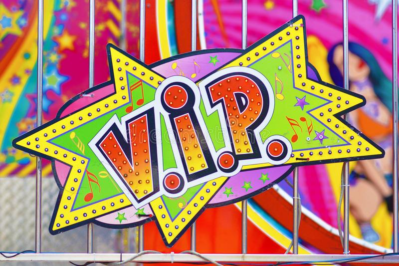 Colorful retro comic style sign saying `V.I.P.` on funfair attraction stock photography