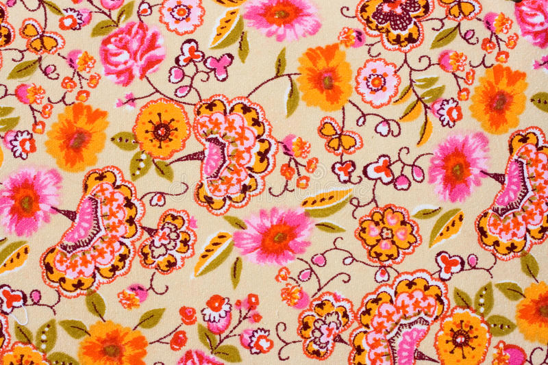Colorful retro tapestry textile pattern. Fragment of colorful retro tapestry textile pattern with floral ornament useful as background royalty free stock photography
