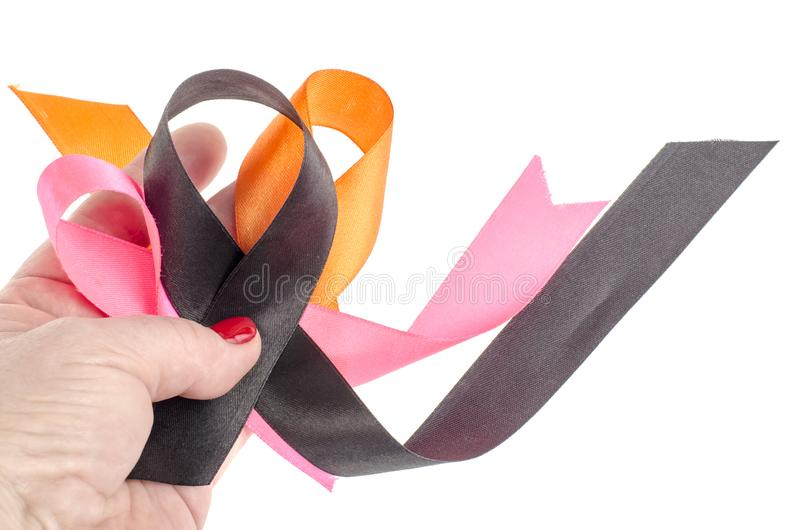 Colorful ribbons on hand, cancer awareness. Studio Photo stock photography