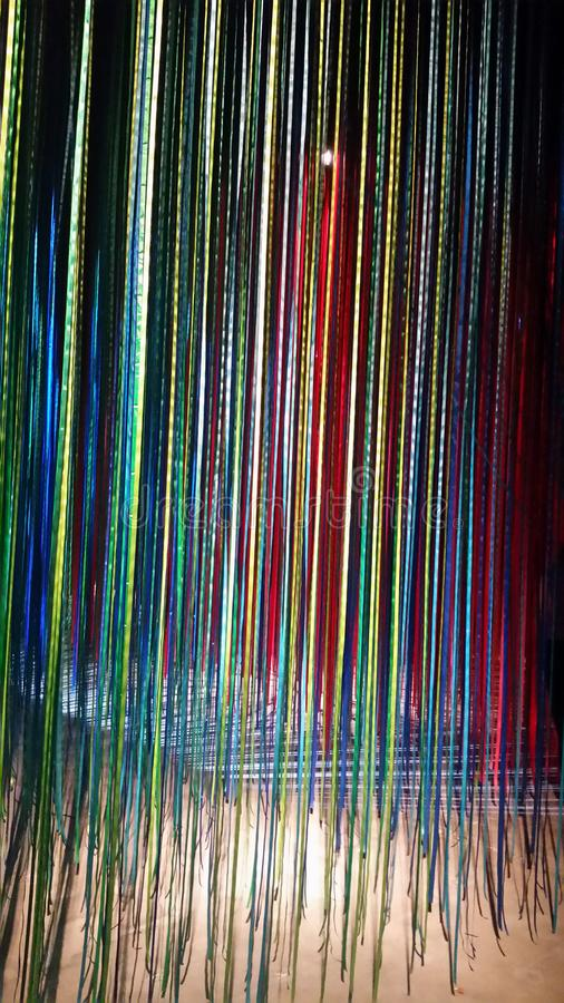 Colorful ribbons in lights stock photo