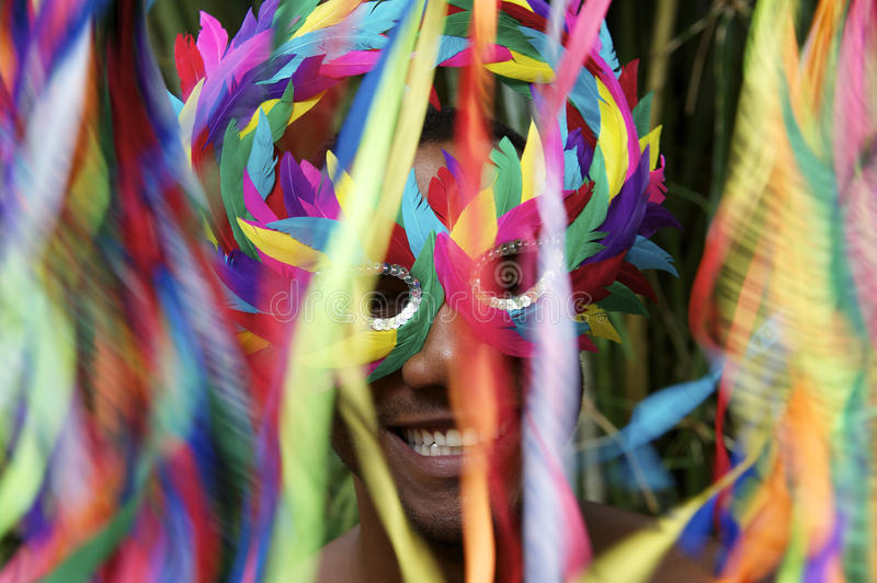Colorful Rio Carnival Smiling Brazilian Man in Mask stock photos