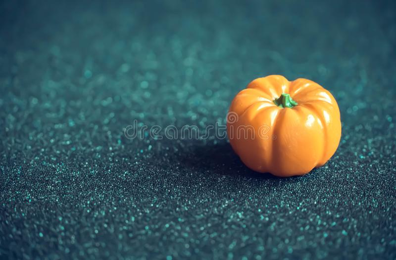 Decorative ripe pumpkin on dark background. Close-up. Artistic photography stock photo