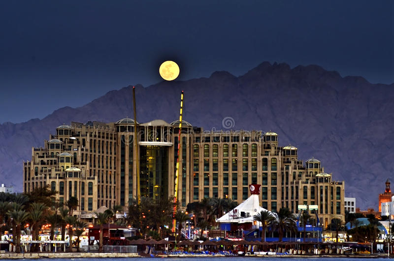 Colorful rise of full moon in Eilat, Israel. The shot was done in Eilat city - a famous resort and recreation city of Israel royalty free stock photography