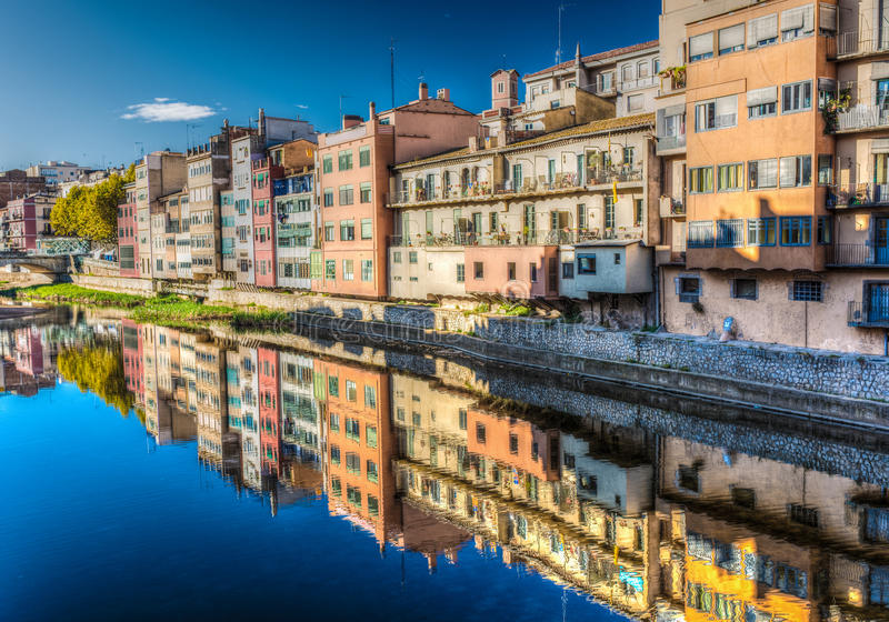 Colorful river-front houses of all shapes and sizes, painted in royalty free stock photography