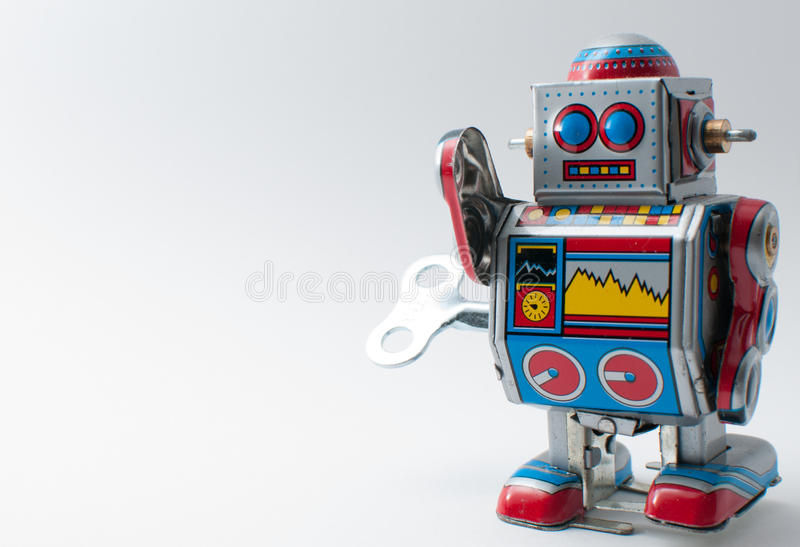 Colorful robot with mechanical wind up key royalty free stock images
