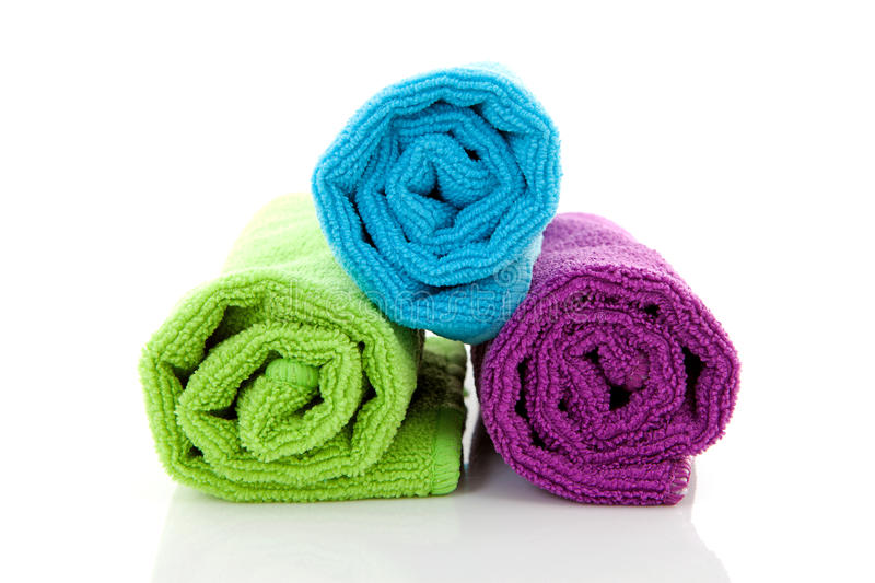 Colorful rolled towels. Over white background royalty free stock photography