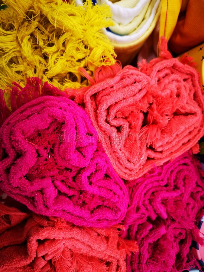 Colorful rolled towels for the bathroom. Textile details edges royalty free stock image