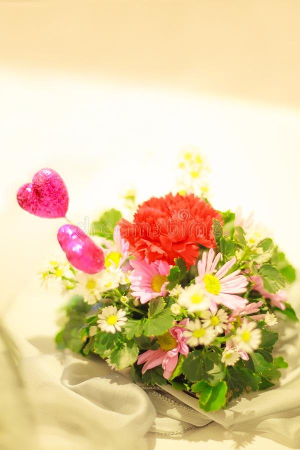 Colorful Romantic Flower Bouquet With Pink Hearts On White Table
