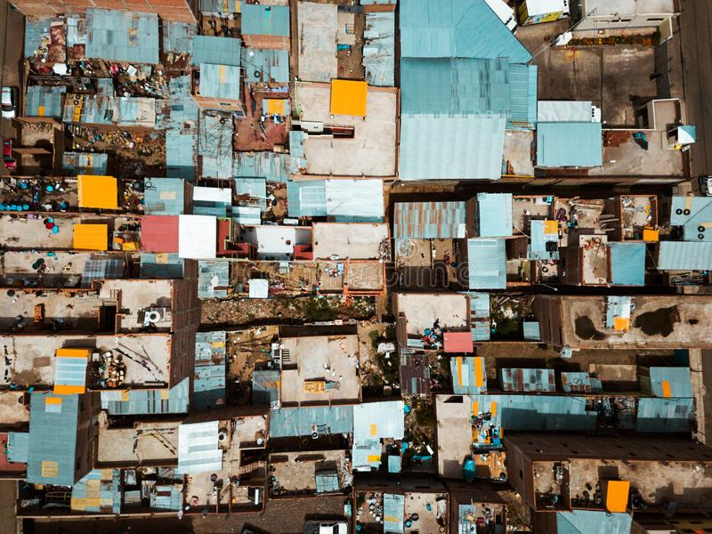 Colorful rooftops of slums. Colorful rooftops of South American slums houses aerial roofs peru puno poor cheap ghetto poverty colors blue orange streets drone royalty free stock photo