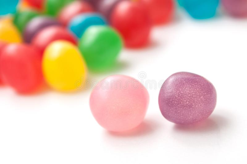 Colorful round candies on white background stock image