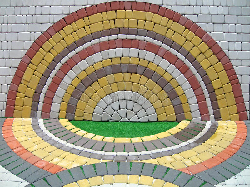 Colorful round construction brick wall, symmetry, royalty free stock photos