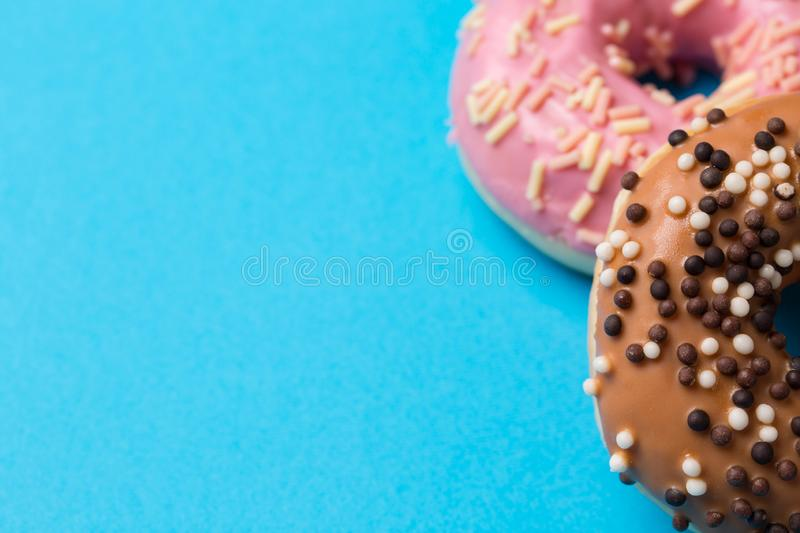 The Colorful round donuts on blue background. royalty free stock images