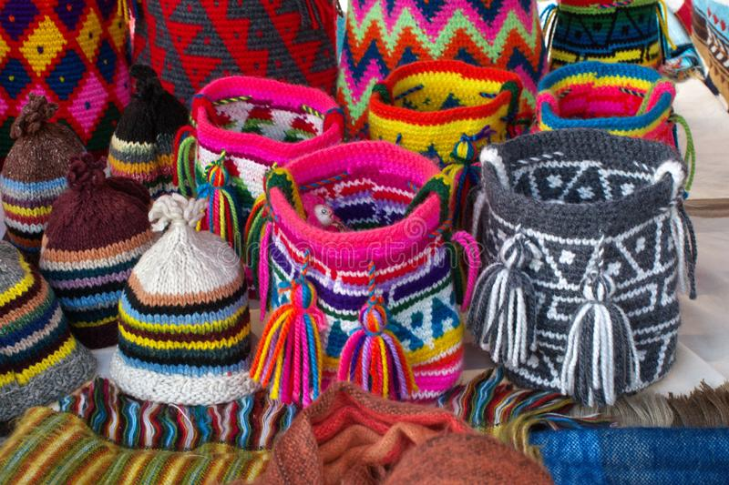 Round, knit purses and hats royalty free stock photos
