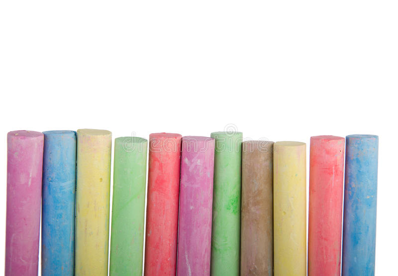 Colorful row of chalk sticks. With copy space isolated on a white background royalty free stock photos
