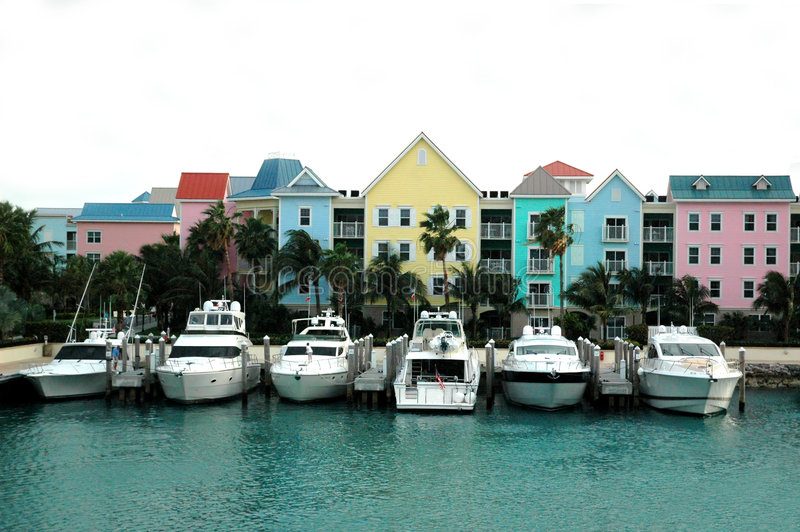 Colorful row of houses and boats. Colorful row of tropical houses and boats in Nassau, bahamas royalty free stock image