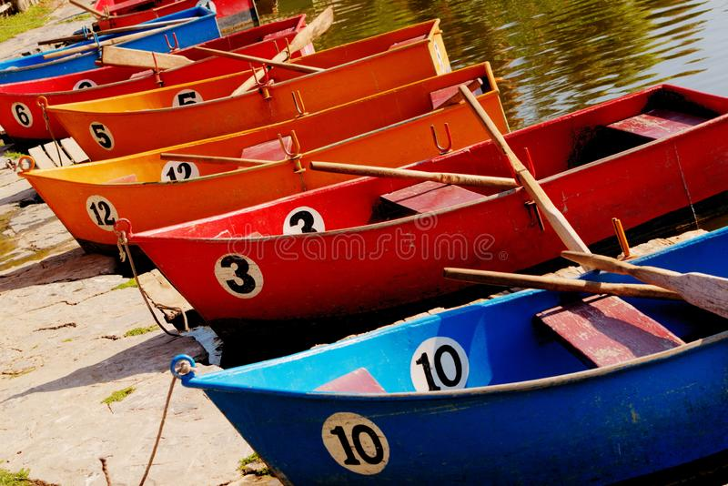 Colorful Rowing Boats Marked with Numbers stock photos