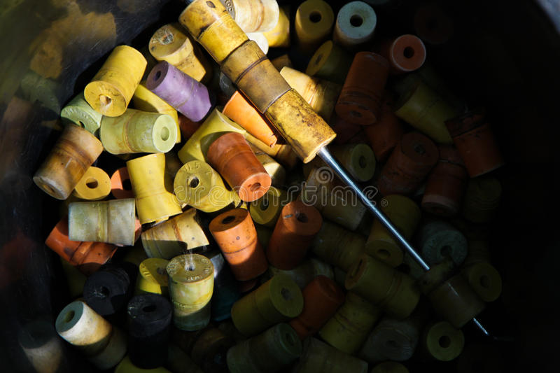 Colorful rubber bottle cap. Plant propagation in the laboratory requireds rubber stopper or cap to prevent germ, fungus, bacteria outside the bottle stock photography