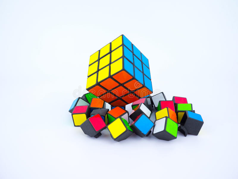 Colorful Rubik's cube and broken cube pieces. Bangkok, Thailand - October 27th, 2016: Colorful Rubik's cube and broken cube pieces on white background stock photos