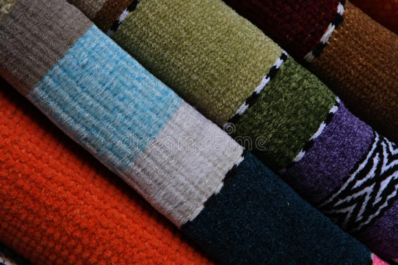 Colorful rugs in the market stock photography
