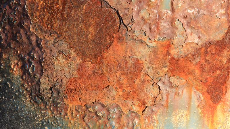 Colorful Of Rusty. Rusty texture on metal. Multicolored rusty steel of bridge pillar on Baltic seaside in Germany royalty free stock images