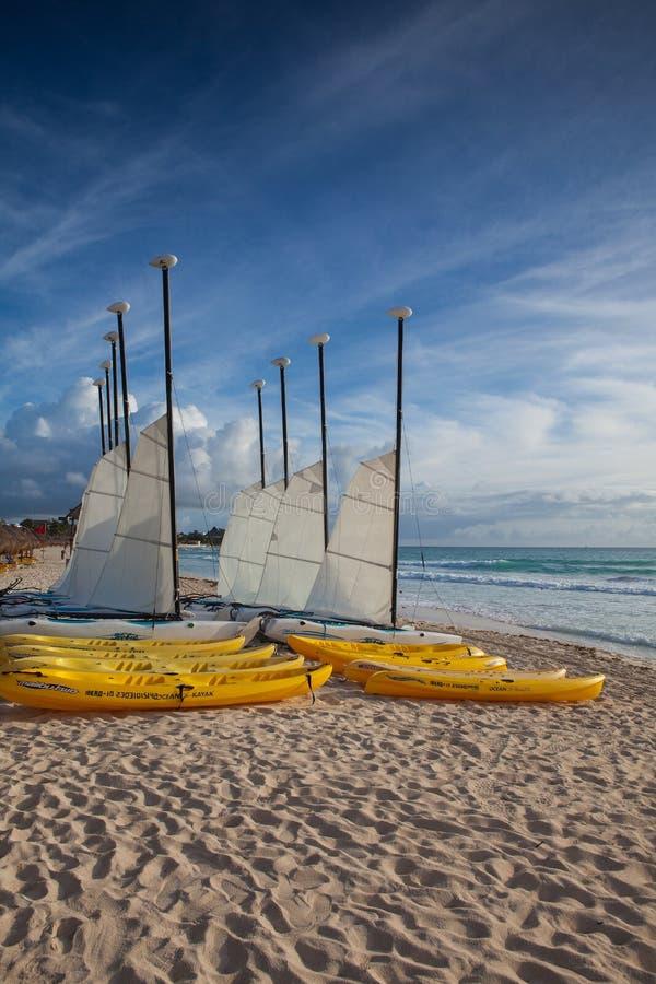 Colorful sail catamarans on the beach at Caribbean Sea of Mexico. stock image