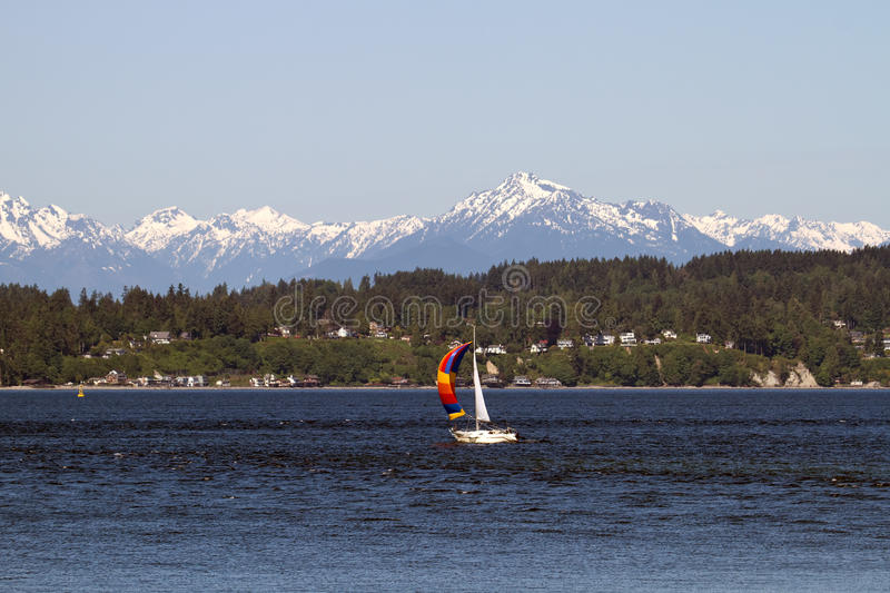 Colorful Sailboat on Puget Sound Olympic Peninsula royalty free stock photos