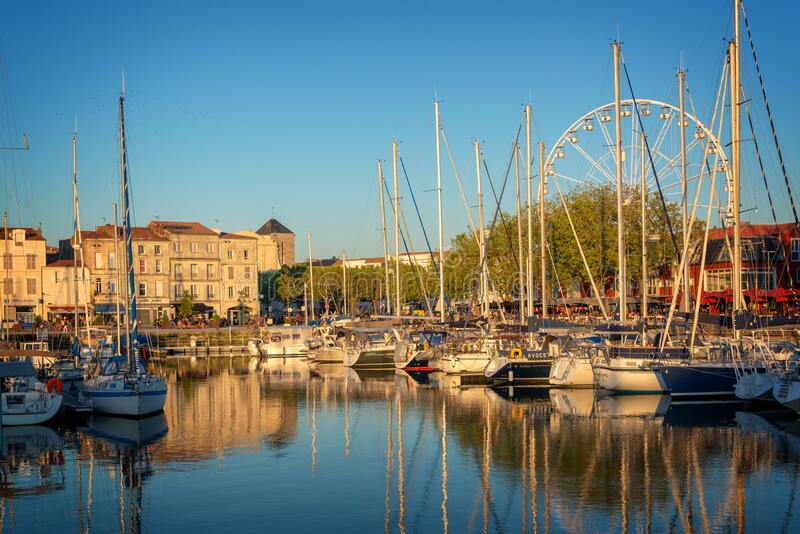 Colorful sailboats at sunset in the old harbor of La Rochelle France royalty free stock photography