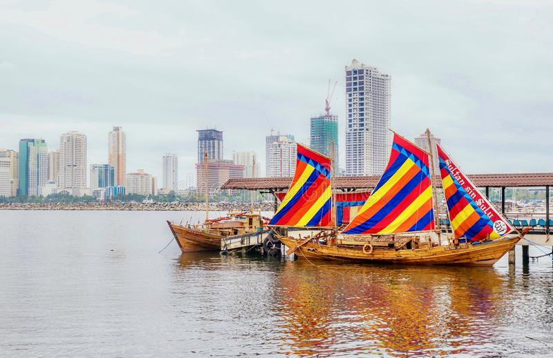 Colorful sails hoisted on a traditional Filipino boat called a balangay. stock photography