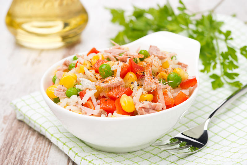 Colorful salad with corn, green peas, rice, red pepper and tuna royalty free stock image