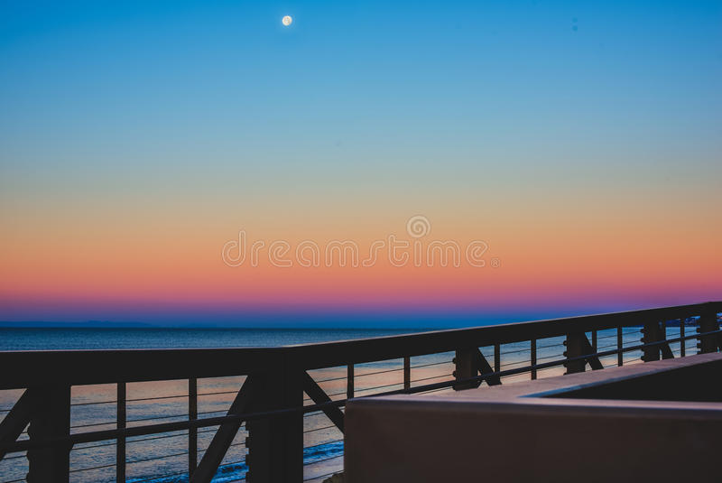 Colorful san clemente horizon. The Moon setting over a colorful horizon in San Clemente, California stock image