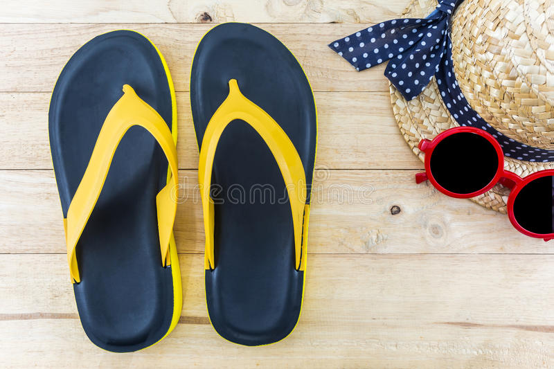 Colorful of Sandals shoes / Orange and black colors flip flops. Colorful of Sandals shoes / Orange and black colors flip flops on white background royalty free stock image