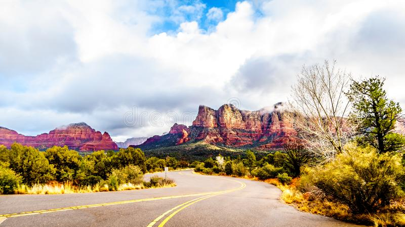 The colorful sandstone mountains of Twin Buttes and Munds Mountain near the town of Sedona. In northern Arizona in Coconino National Forest, USA stock image