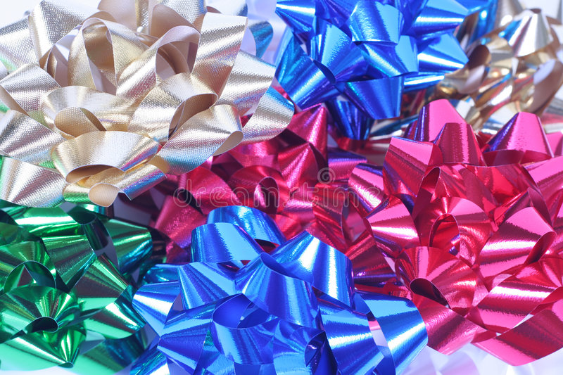 Colorful satin bows in a pile royalty free stock photos