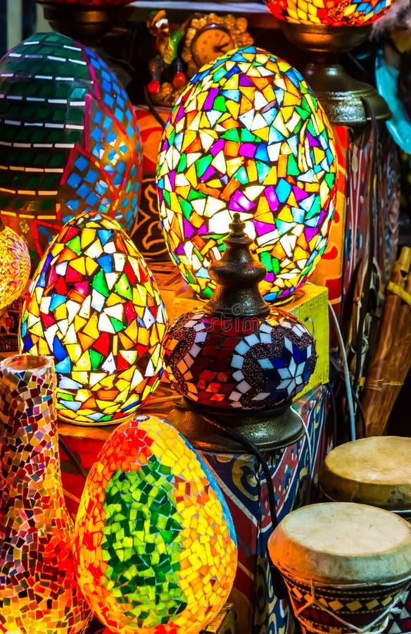 Colorful scattered-mosaic lamps, Moez street. Colorful scattered-mosaic lamps on display with oriental tablas  drums, darbula, in El Muez Muizz, Moez Street in stock photography