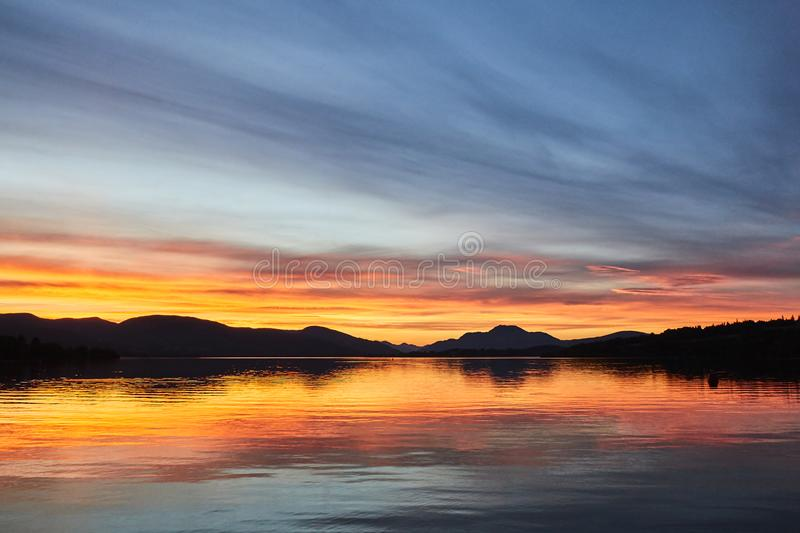 Colorful scenic sunset view of Loch lomond lake in Scotland, United Kingdom. stock images