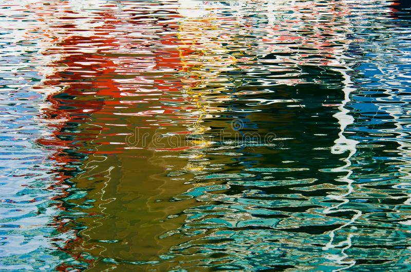 Colorful reflections on sea water - beautiful water background, Norway, Norwegian Sea, rave of colors. Colorful sea water reflections on clear Norwegian Sea royalty free stock photo