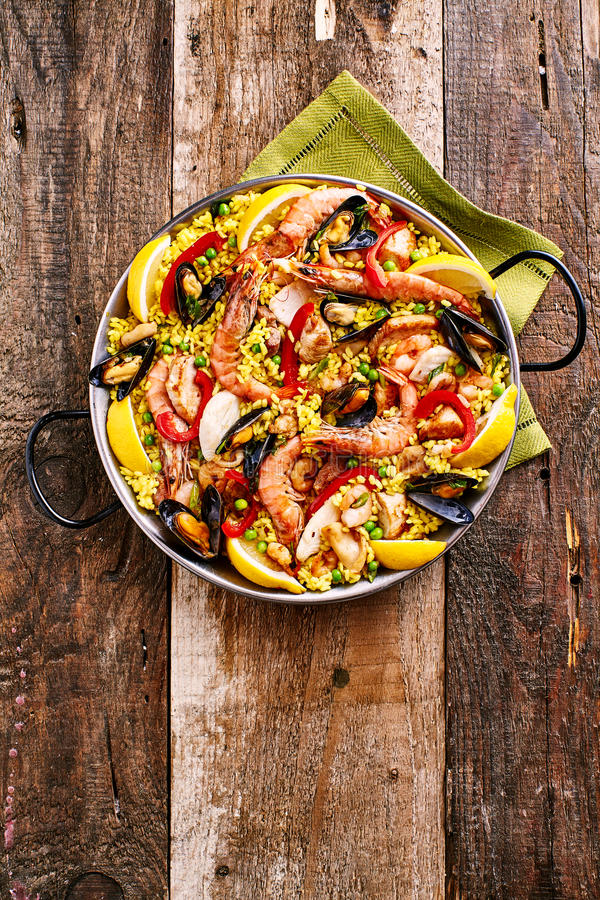Colorful Seafood Paella Dish With Shellfish Stock Photo
