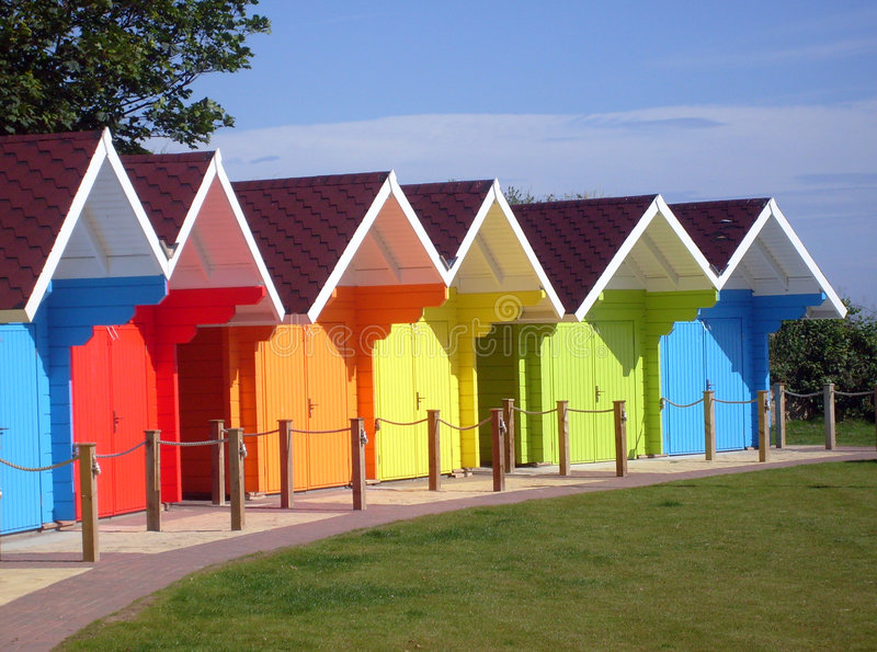 Colorful seaside beach chalets. Exteriors of beautiful bright seaside beach chalets, Scarborough, England royalty free stock photography
