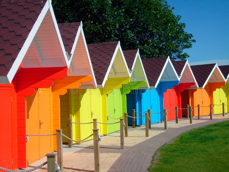 Colorful seaside beach chalets. Exteriors of beautiful bright seaside beach chalets, Scarborough, England stock images