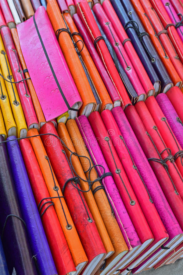 Colorful Second Hand book cover for sale. Colorful Second Hand book cover with floral pattern for sale in European flea market. It looks like covering note book royalty free stock image