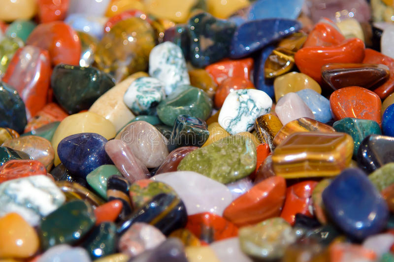 Colorful semi-precious stones in bulk. stock photography