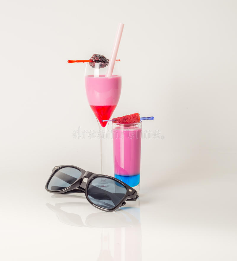 Colorful set of drinks, color drink decorated with fruit, sunglasses, drink straw, color shots stock images