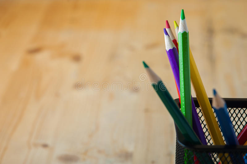 Colorful sharpened pencils on wooden table royalty free stock photography