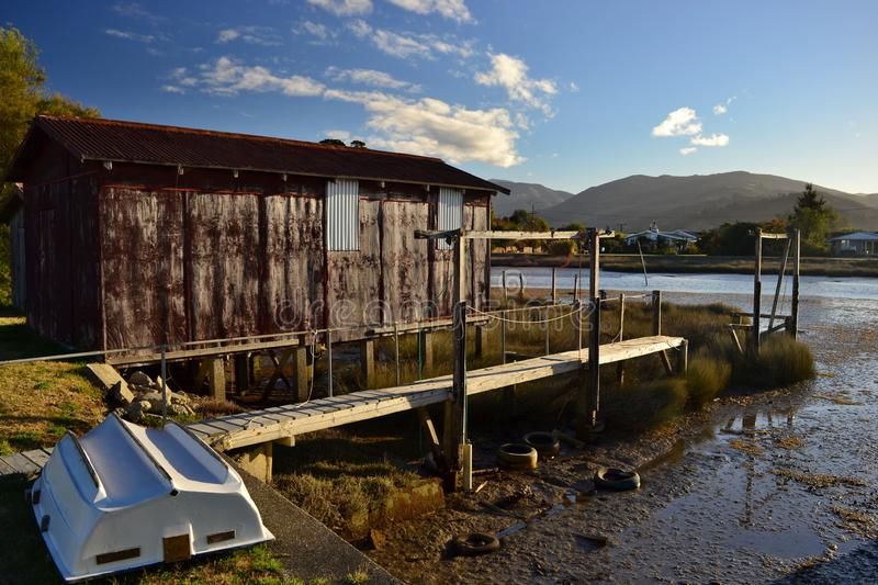 Colorful sheds by the river bank for fisherman stock photography