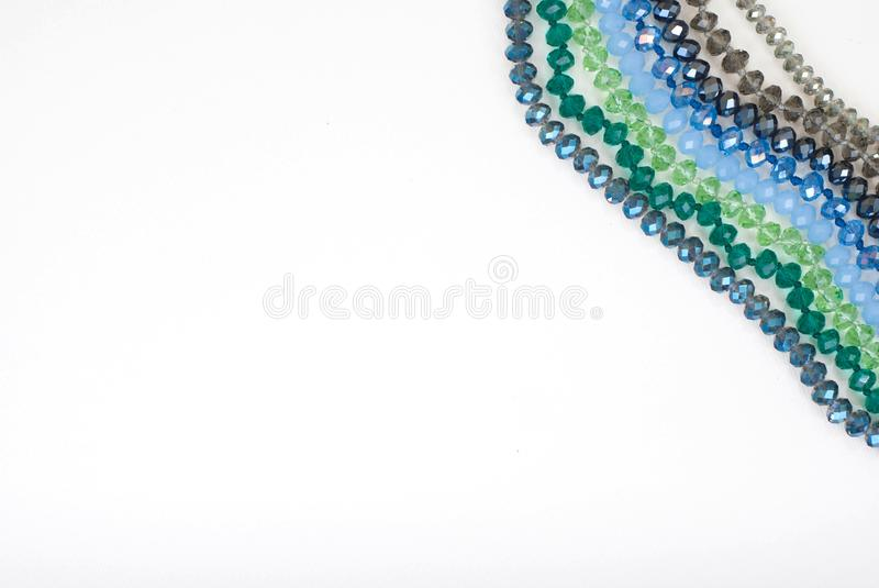 Colorful Shinny Crystal Beads Glass Isoalted on White Background Copy space for Text Fashion Beauty. Colorful Shinny Crystal Beads Glass Isoalted on White royalty free stock image