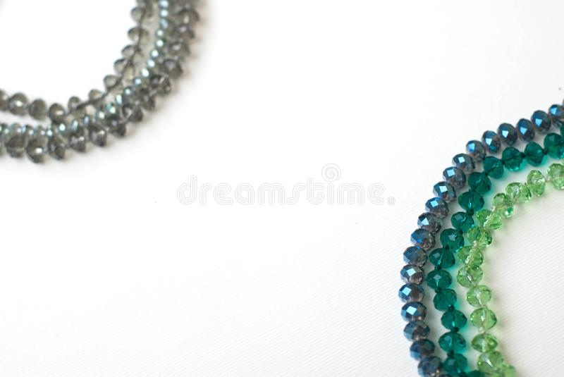 Colorful Shinny Crystal Beads Glass Isoalted on White Background Copy space for Text Fashion Beauty. Colorful Shinny Crystal Beads Glass Isoalted on White royalty free stock photo