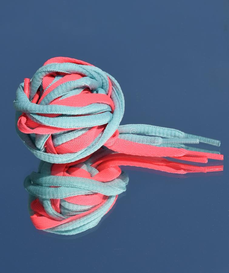 Colorful Shoe Laces Tangled Up As Ball With Reflection On
