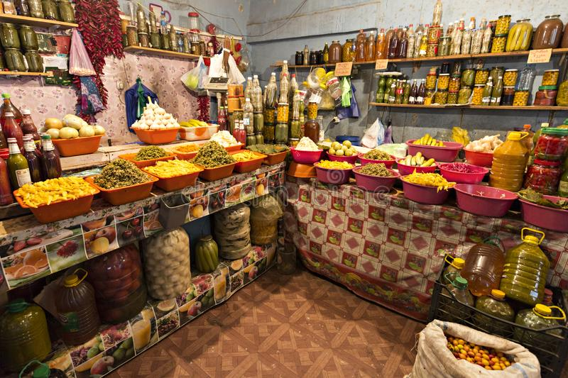 Colorful shop selling pickled fruits and vegetables. stock photos