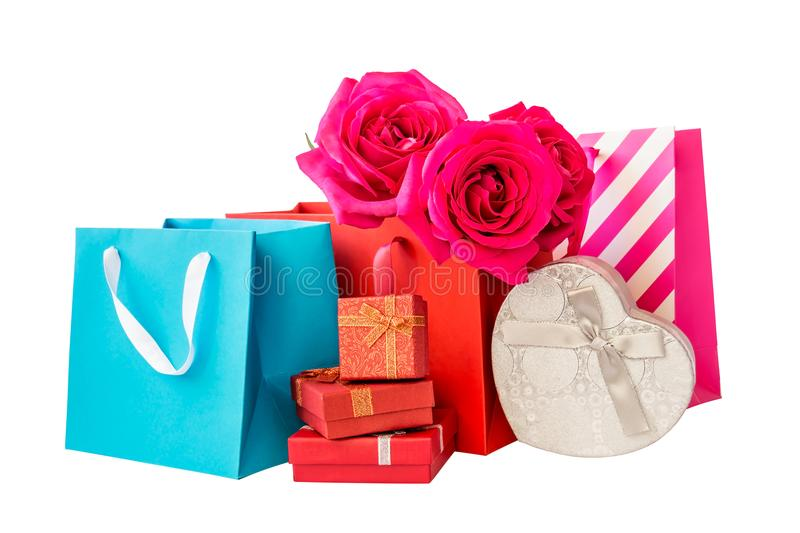 Colorful shopping bags, gift boxes and roses isolated on white stock photography