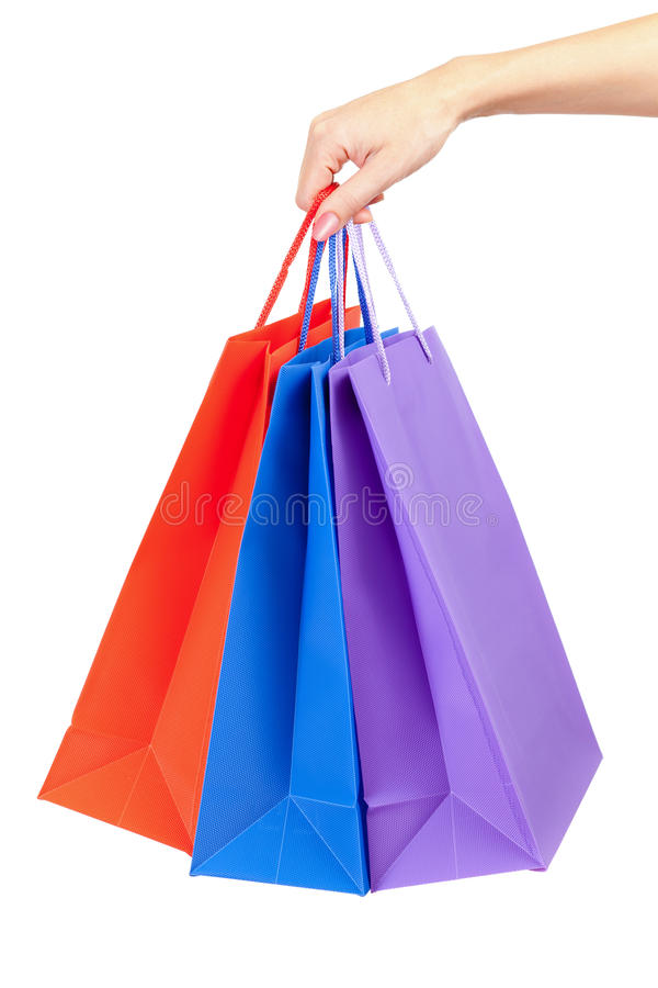Colorful shopping bags in hand isolated royalty free stock photography